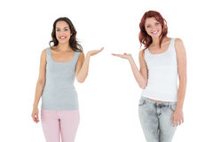 Two happy young female friends holding out their hands Stock Photography