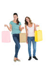Two happy young female friends with shopping bags Stock Photos