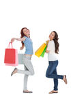 Two happy young female friends with shopping bags Stock Image