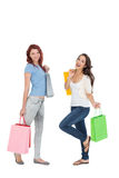 Two happy young female friends with shopping bags Royalty Free Stock Photography