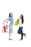Two happy young female friends with shopping bags Royalty Free Stock Images