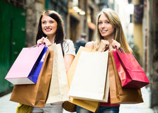 Two happy young girl going shopping. In European city Royalty Free Stock Images