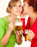 Two happy young girlfriends talking, gossip Royalty Free Stock Photos