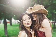 Two happy young girls in boho chic style clothes Royalty Free Stock Photography