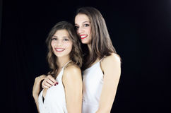 Two happy young girls dressed in white Stock Photography