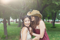 Two happy young girls in summer park Stock Image