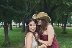 Two happy young girls in summer park Stock Photos