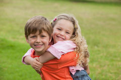 Two happy young kids playing at park Stock Photos