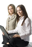 Two happy young manager women. Two happy young manager ladies with notebook on white background Royalty Free Stock Photography