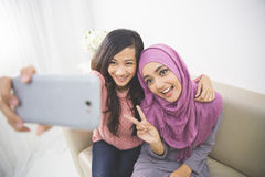 Two happy young muslim woman take self portrait Royalty Free Stock Photography