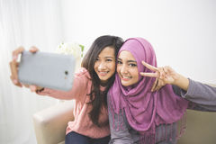 Two happy young muslim woman take self portrait Stock Photo