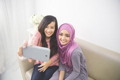 Two happy young muslim woman take self portrait Royalty Free Stock Photos