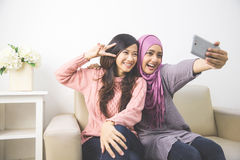 Two happy young muslim woman take self portrait Royalty Free Stock Images