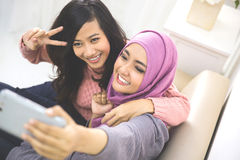 Two happy young muslim woman take self portrait Royalty Free Stock Image