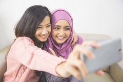 Two happy young muslim woman take self portrait Stock Photography