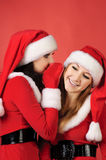 Two happy young Santa girl talking Royalty Free Stock Images