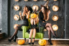 Two happy young women in black witch halloween costumes on party Stock Image