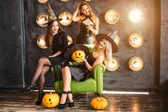 Two happy young women in black witch halloween costumes on party Stock Photo