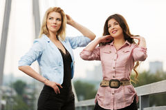 Two happy young women on the bridge Royalty Free Stock Photo