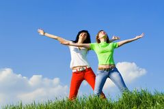 Two happy young women dreams Stock Photography