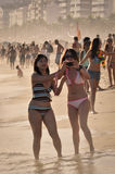 Two happy young women enjoy Carnival in Ipanema beach Royalty Free Stock Image