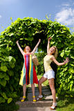 Two happy young women enjoying summer Stock Image