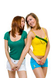Two happy young women friends walk together Stock Photo