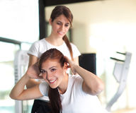 Two happy young women in the gym Stock Photo
