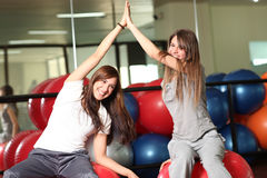 Two happy young women in the gym Royalty Free Stock Image