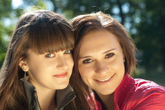 Two happy young women headshot Stock Photography