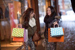 Two happy young women holding shopping bags Royalty Free Stock Image
