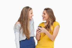 Two happy young women looking a smartphone Stock Photo