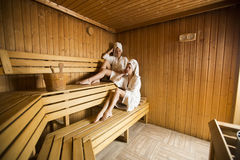 Two happy young women relaxing in dry sauna Royalty Free Stock Image