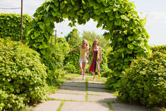 Two happy young women are runing in a park Stock Images
