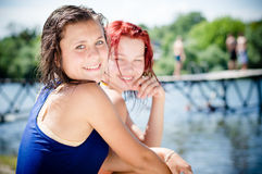 Two happy young women sharing joyful time outdoors Stock Photo