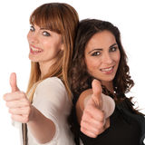 Two happy young women with thimbs up Royalty Free Stock Photos