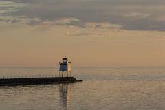Two Harbors Breakwater Lighthouse. A lighthouse on a breakwater at sunset stock image