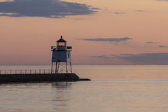 Two Harbors Breakwater Lighthouse. A lighthouse on a breakwater after sunset royalty free stock photo
