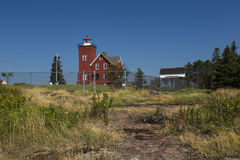 Two Harbors Lighthouse. An old red brick lighthouse along Lake Superior in Minnesota royalty free stock photography