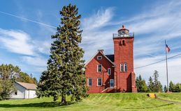 Two Harbors Lighthouse on a Knoll of Grassy Lawn royalty free stock photography