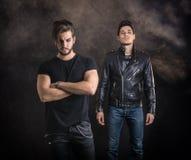 Two hard rock men posing in studio. Royalty Free Stock Image