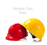 Two hardhats on white background with copy space Royalty Free Stock Images