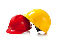 Two hardhats on white background with copy space Stock Images