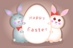 Two hare keep the egg with a wish. Bunny rabbit boy and girl holding a greeting card with a wish Happy Easter Royalty Free Stock Photo