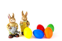 Two hares with Easter eggs. Two hares with colored Easter eggs Royalty Free Stock Images