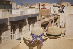 Two hats on the balcony in European city, vacation concept. Two hats on vacation in urban Europe, luxury vacation concept Stock Image
