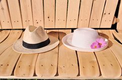 Two hats on a bench. Royalty Free Stock Images