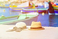 Two hats with traditional maltese boats on. Background, honeymoon and summer vacation Royalty Free Stock Images