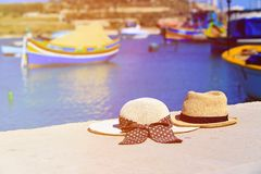Two hats with traditional maltese boats on. Background, honeymoon and summer vacation Royalty Free Stock Photo