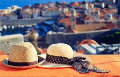 Two hats on vacation in Europe, romantic travel Stock Image